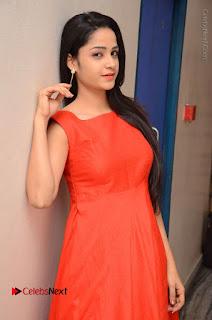 Telugu Actress Divya Nandini Stills in Orange Sleeveless Gown at Chennai Chaitrama Movie le Launch Event  0041.JPG