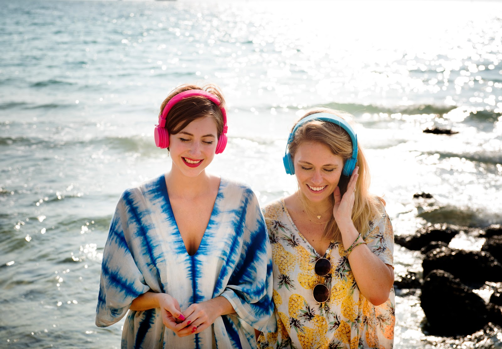 Girls With Color Headphones On Beach