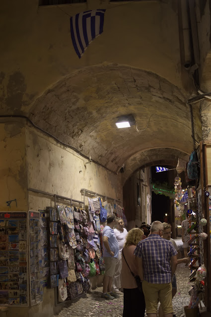 Even in the smallest streets you can find open shops during the summer. In Rhodes, Greece.