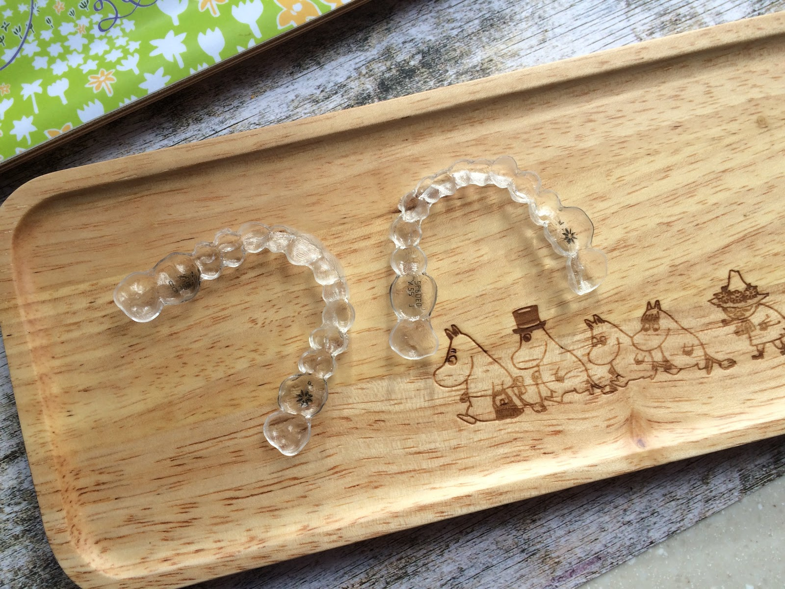 Invisalign trays on a moomin wooden tray