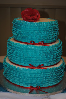 Turquoise And Red Ribbon Wedding Cake