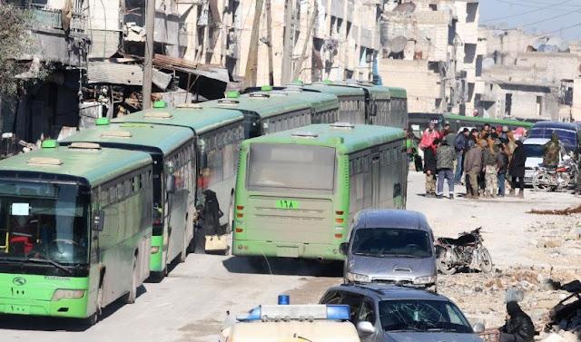 A rede de televisão estatal Síria diz que o último comboio de rebeldes e civis deixaram Aleppo como parte das operações para evacuar a cidade