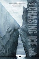 Chasing Ice poster with two massive icebergs colliding, a tiny boat between them