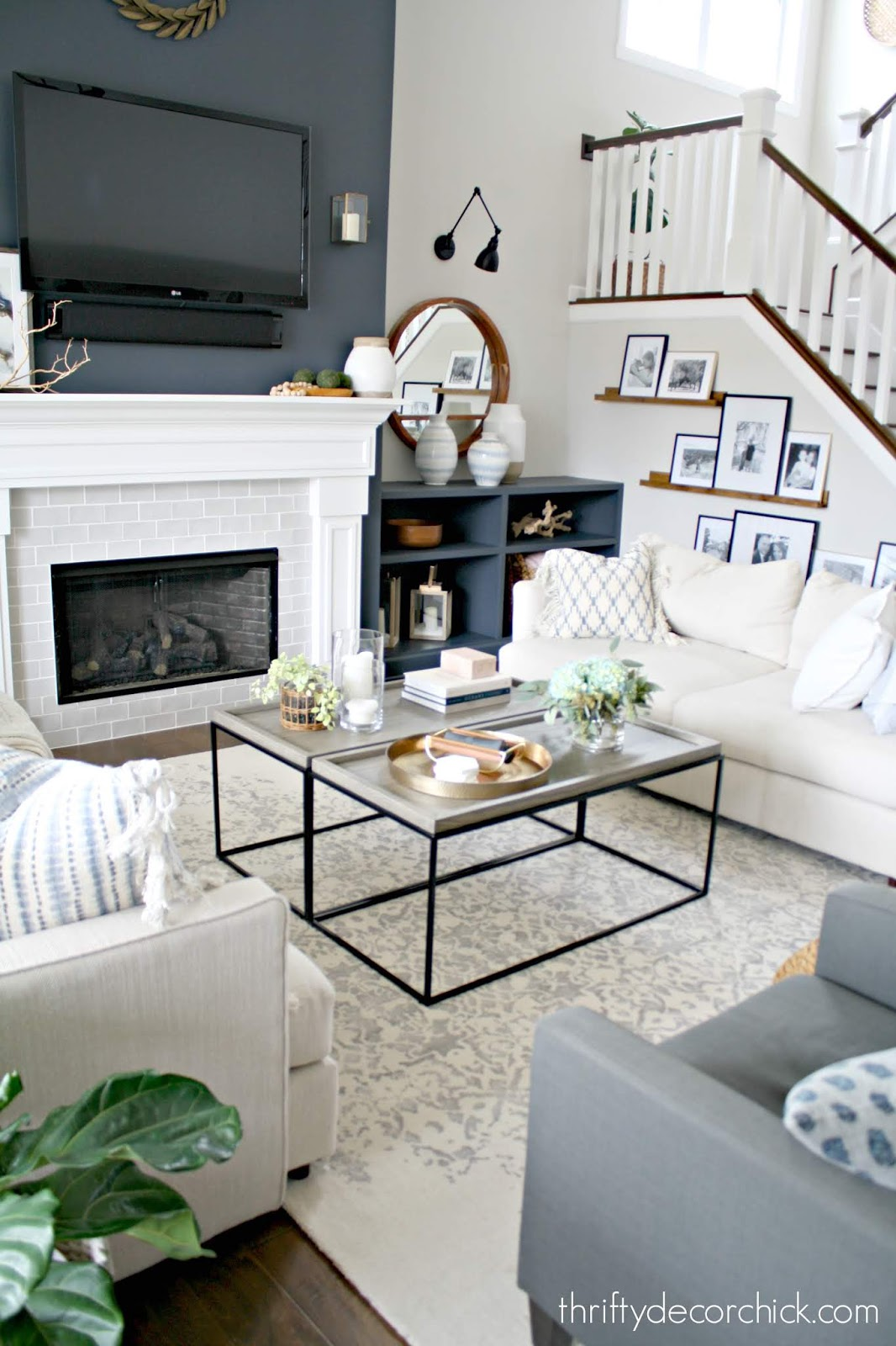 Symmetrical family room with two sofas, chairs and tables