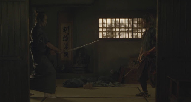 Swords drawn in close quarters, Iguchi faces Zenemon in the movie's pivotal scene