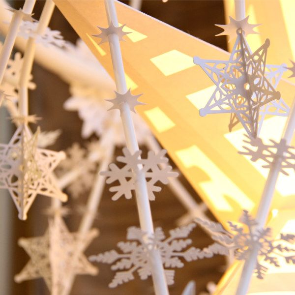 white paper stars and snowflakes
