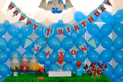 Balloon decoration wall with Happy Birthday garland and sweet table