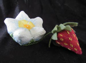 stuffed fabric flower and strawberry wit embroidered details