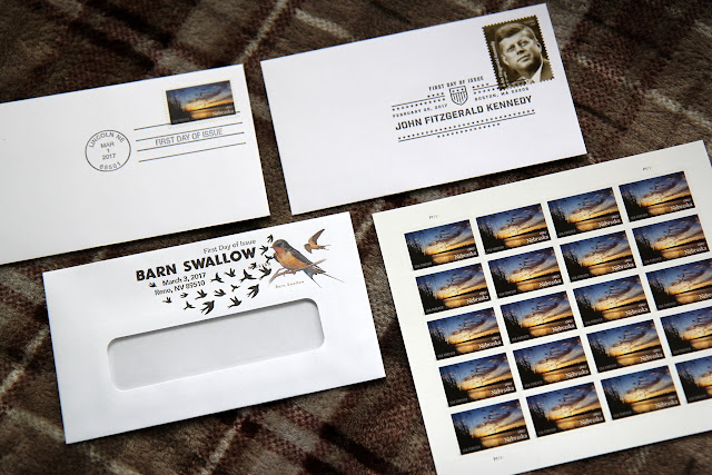 This month's philately report includes the JFK, Barn Swallow, and Nebraska first-day covers. We also have a giveaway!