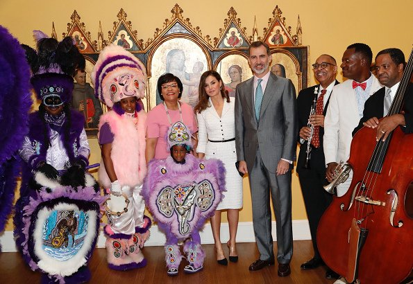 Queen Letizia wore Felipe Varela white dress and Magrit pumps at the Mardi Gras Indians show at New Orleans Museum of Art in City Park