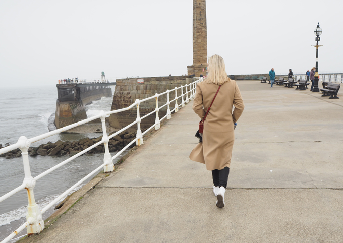Travel Guide to Whitby walking along the pier
