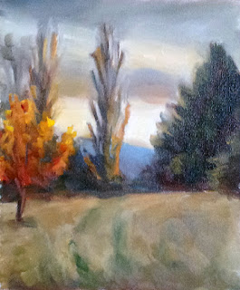 Oil painting of trees in late autumn with a distant blue hill in fading light.
