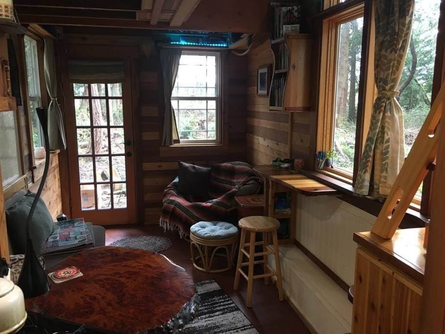 03-Living-Room-and-Dining-Area-Andrew-Airbnb-Tiny-House-Architecture-in-Marrowstone-Washington-www-designstack-co