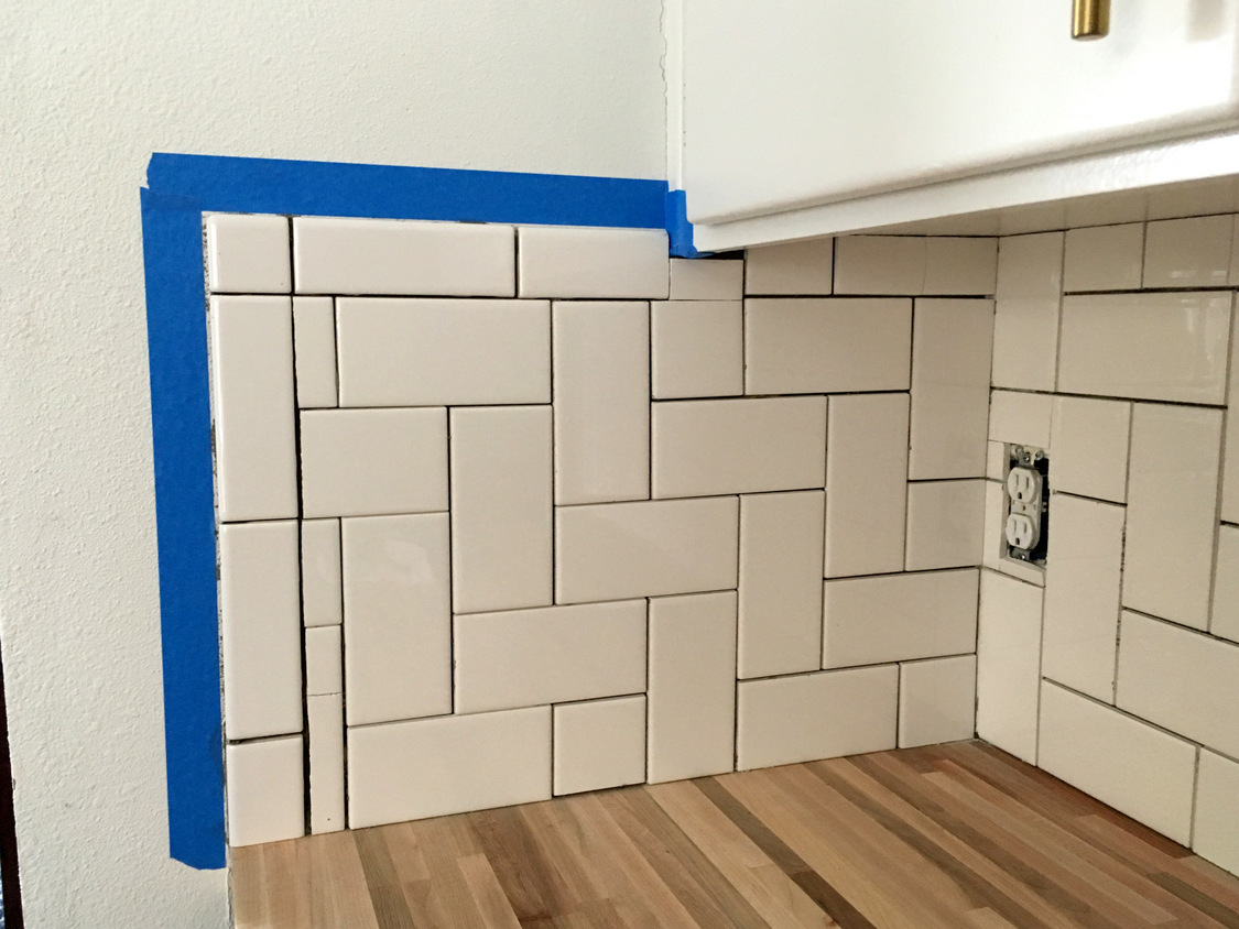 Straight herringbone tile backsplash tutorial create enjoy spread grout onto tilesinto gaps using a grout float flexible spreader or other tool for wall tile i found the grout float was very frustrating and dailygadgetfo Gallery