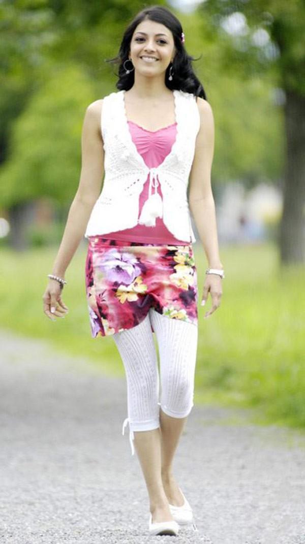 Kajal Agarwal Cute Smiling Stills In Pink Dress