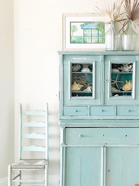Tuquoise vintage country cabinet styled in a beach house by Sherry Hart. Come find Beachy Turquoise Decor Inspiration to float your boat! #turquoise #decorinspiration #beachyblue #vintagecabinet #beachydecor #coastalcottage #aquadecor