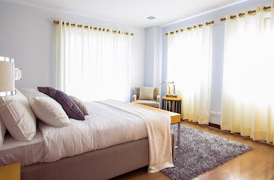 Change the bedding and flip over the mattress of your bed.