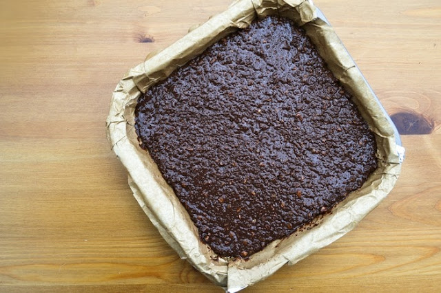 tiffin mixture pressed in lined brownie pan