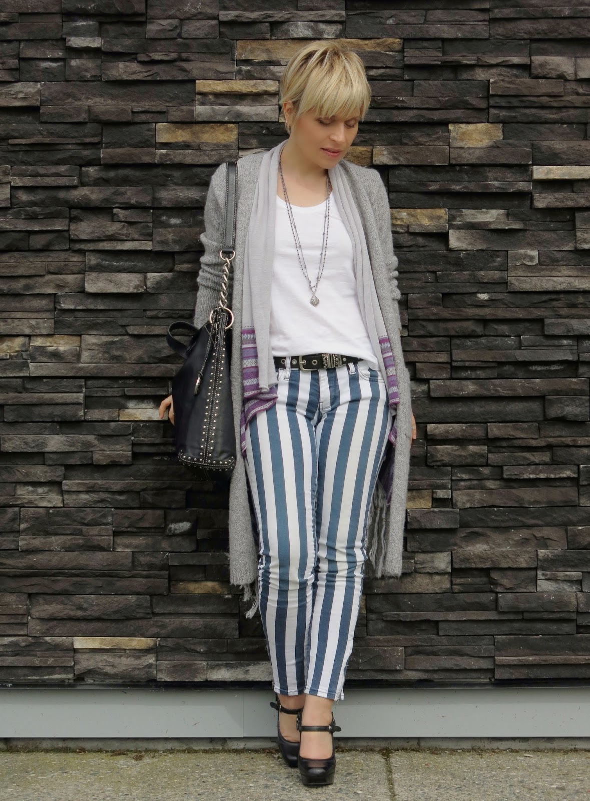 styling a long cardigan with striped skinny jeans and platform shoes