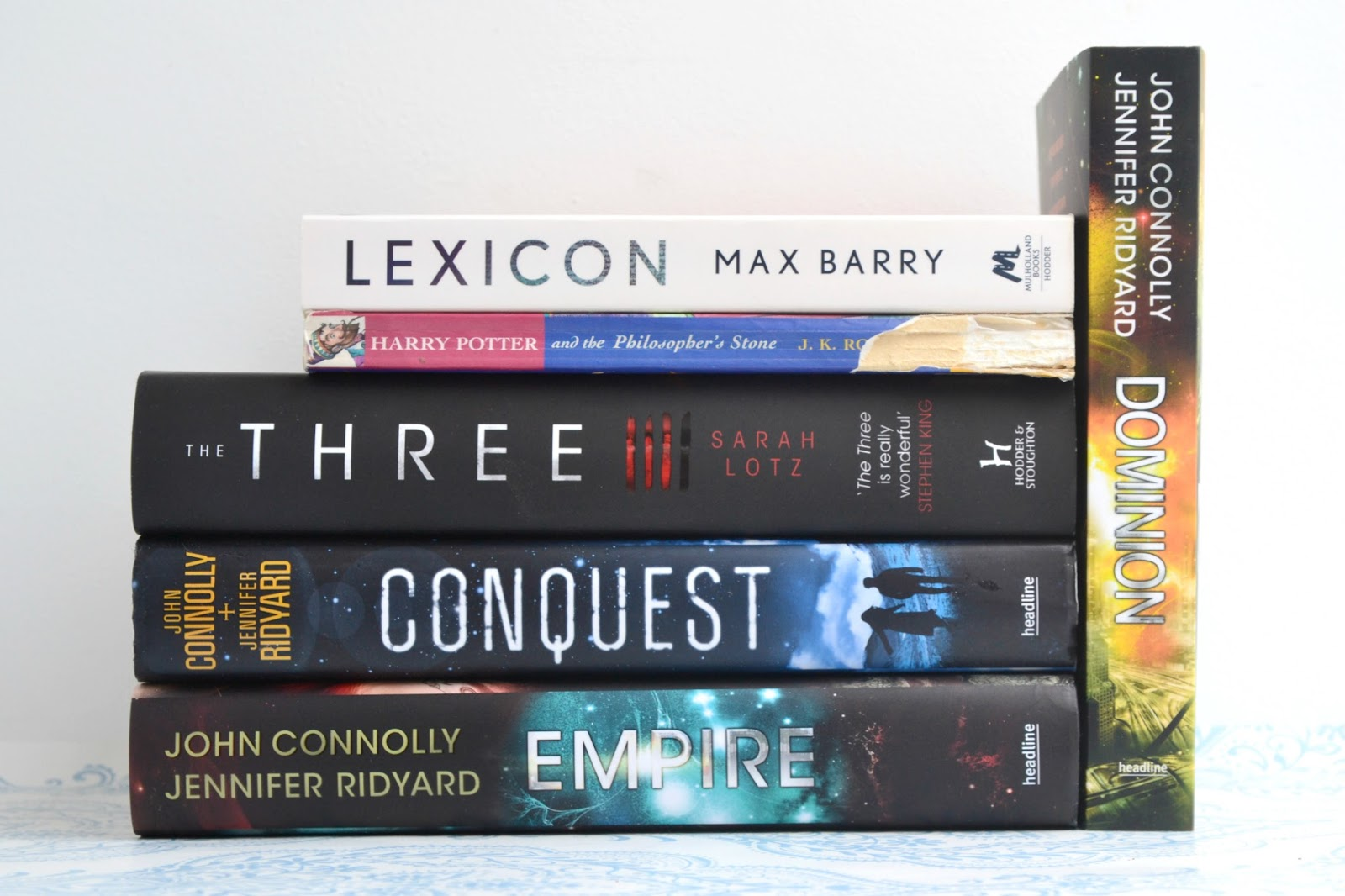 Lexicon by Max Barry, Harry Potter and the Philosopher's Stone by JK Rowling, The Three by Sarah Lotz and Conquest, Empire and Dominion by Jennifer Ridyard and John Connolly.