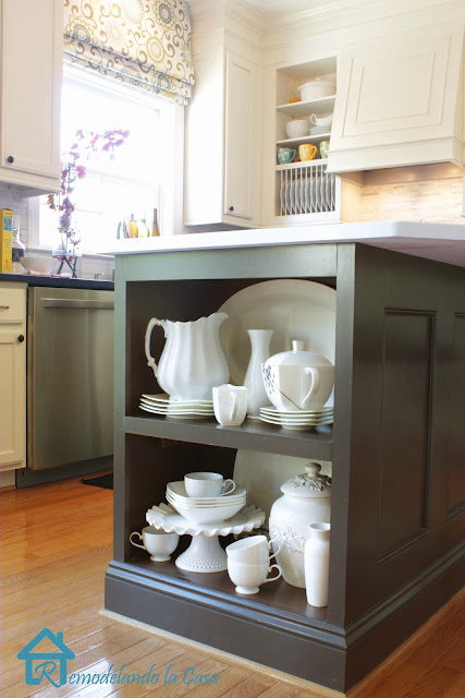 a shelf displaying white dishes in kitchen island transforation