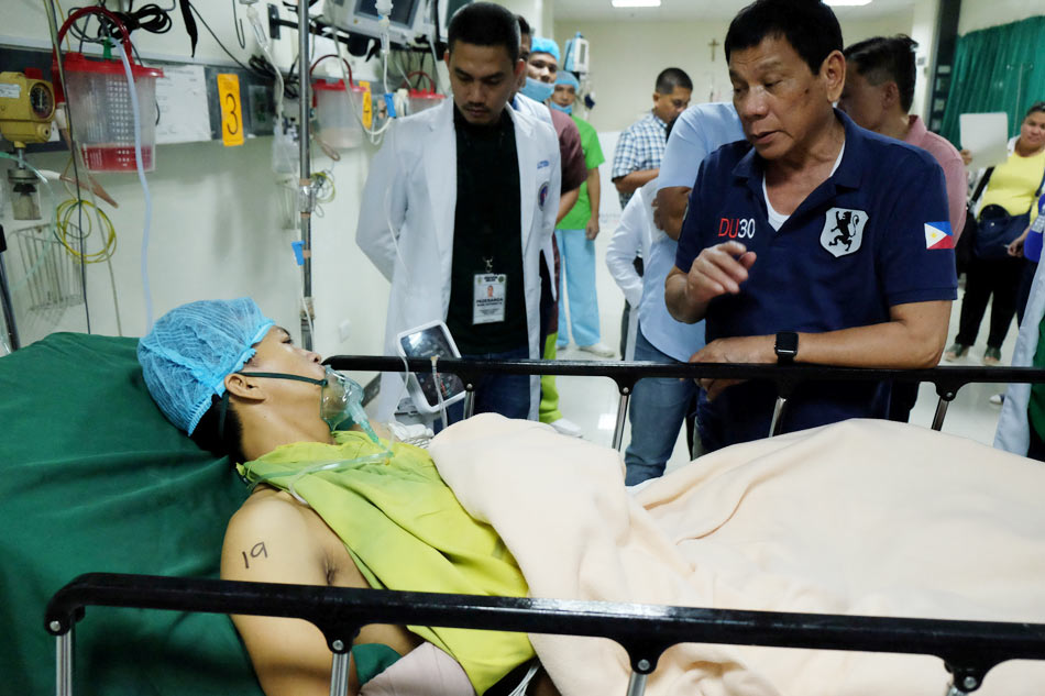 President Rodrigo Duterte visits one of the victims of the Davao blast.