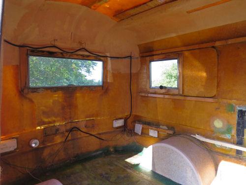 bare interior of a fiberglass trailer
