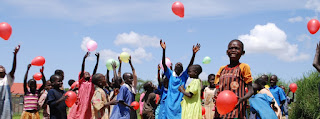 Happiness is a red balloon in Rwanda Africa.