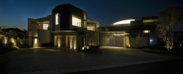 Modern home at night from the street