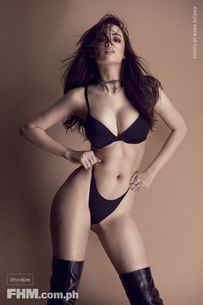 Kim Domingo black bra and panties, black boots