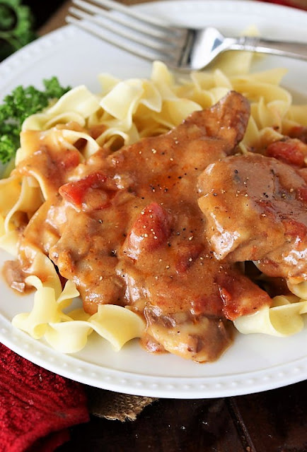 Slices of Creamy Crock Pot Round Steak On a Plate with Noodles Image