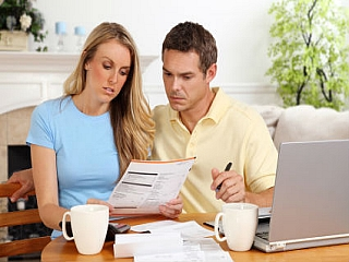 A husband and wife considering a debt consolidation program