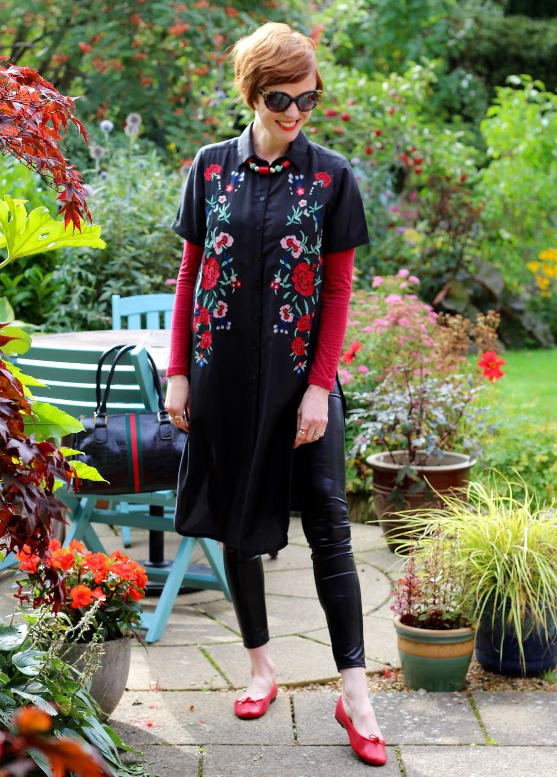 Fake Fabulous | Embroidered long-line shirt, vinyl legging & red ballet pumps, over 40.