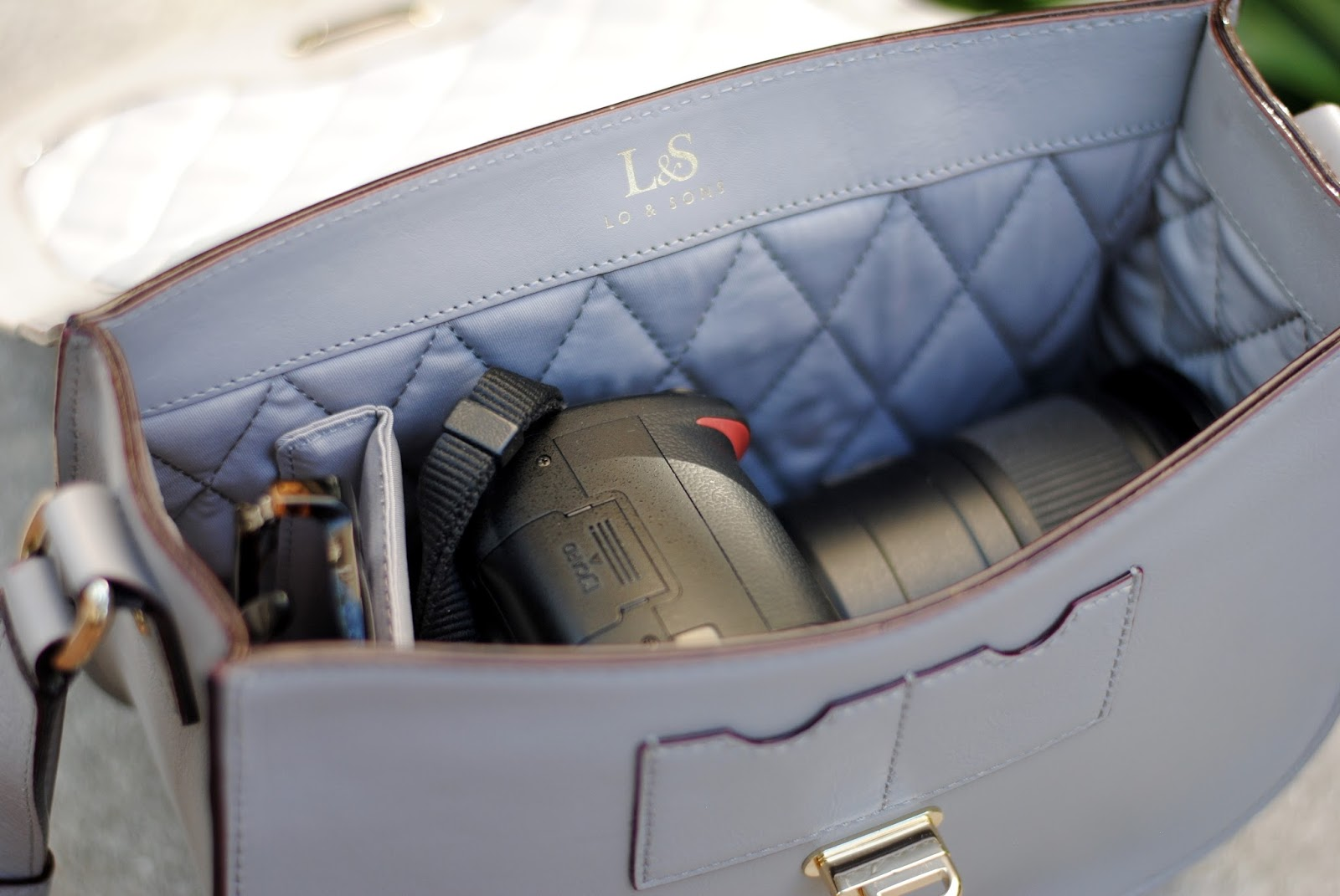 travel style with lo and sons camera bag