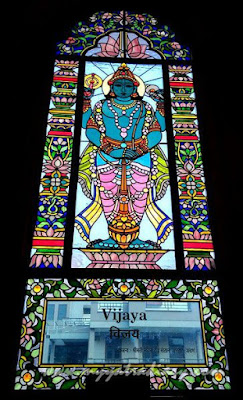 Door man Vijaya stained glass window vedic art gallery - ISKCON Jaipur, Rajasthan