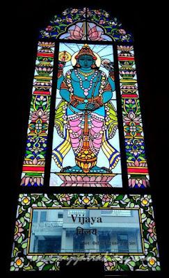 Door man Vijaya stained glass window vedic art gallery - ISKCON Jaipur, Rajasthan