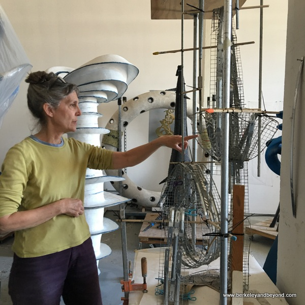 artist Mary Oros points at her armature underpinning in Benicia, California