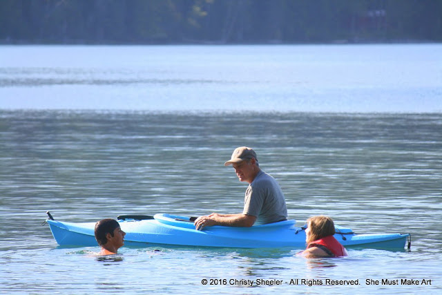 Family time on Lake McDonald, Glacier National Park, Montana, USA.