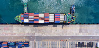 Looking down on cargo ship being loaded (Credit: University of East Anglia) Click to Enlarge.
