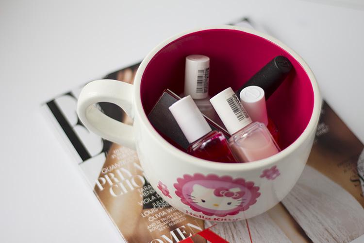 essie nail polish in hello kitty mug