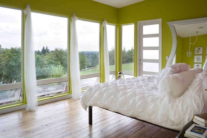 Green bedroom in Contemporary style home in Oregon by Eric Schnell
