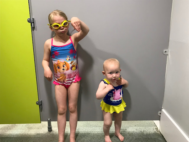My daughters in their swimming costumes ready to go swimming