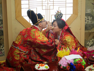 Traditional Korean wedding ceremony at wedding hall - drinking soju