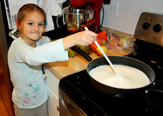 Tessa helped stir the milk for our homemade cheese while it warmed.