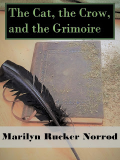 cover for The Cat, the Crow, and the Grimoire showing a book and a feather pen