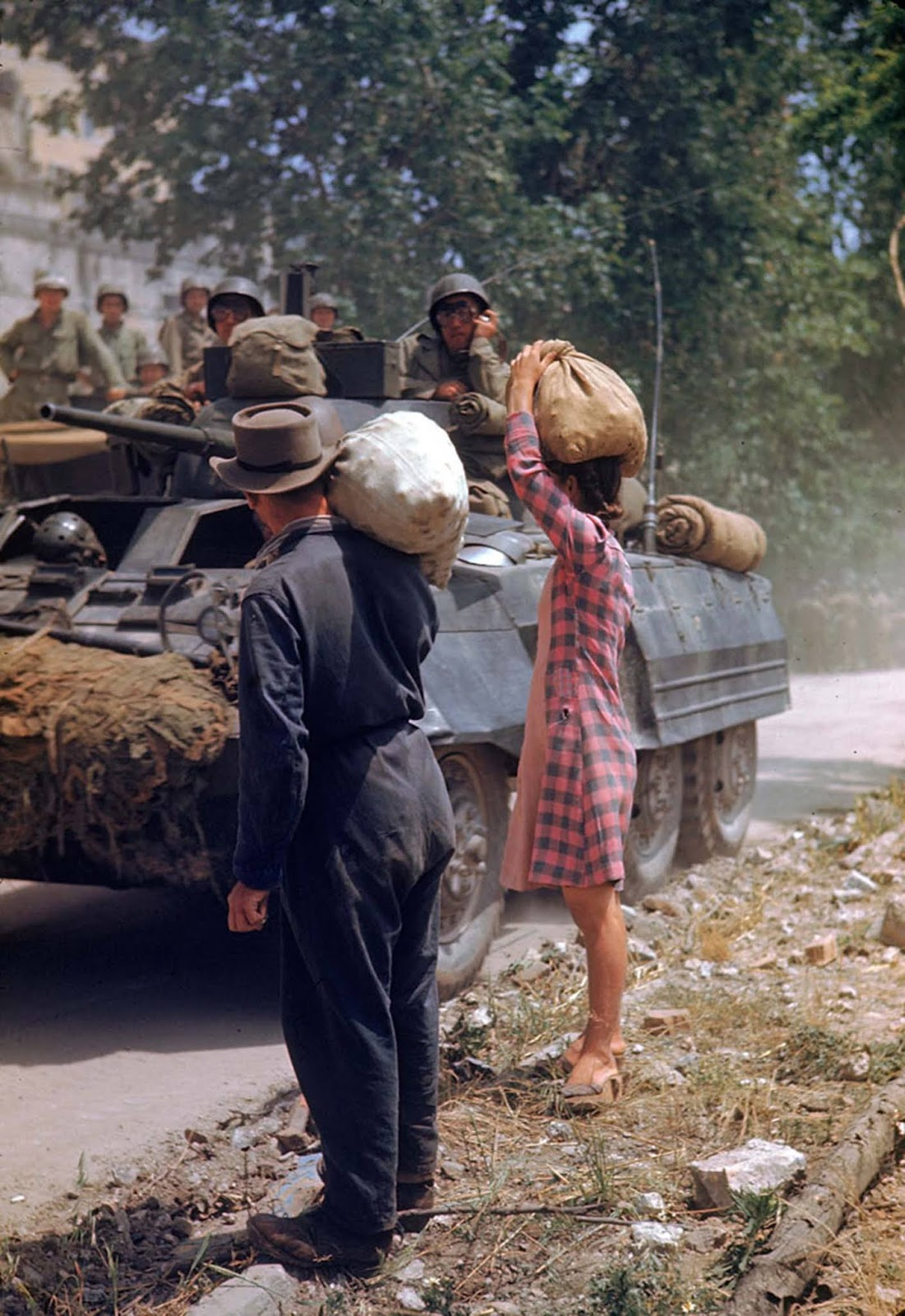 Italians watched American armor pass during the drive towards Rome along the Appian Way, World War II.