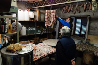 Buying fresh made sausages in Tuscany, Italy