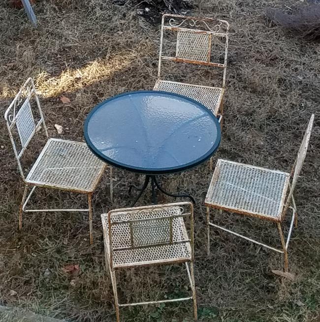 rusty wrought iron patio set