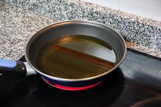 Heat oil in frying pan fritters