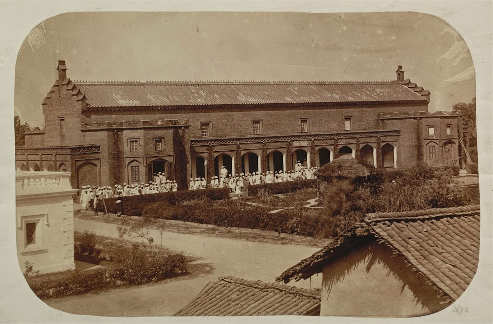 General view of the Government Normal School, Varanasi (Benares), with pupil-teachers leaving the school to go to their barracks - 1870